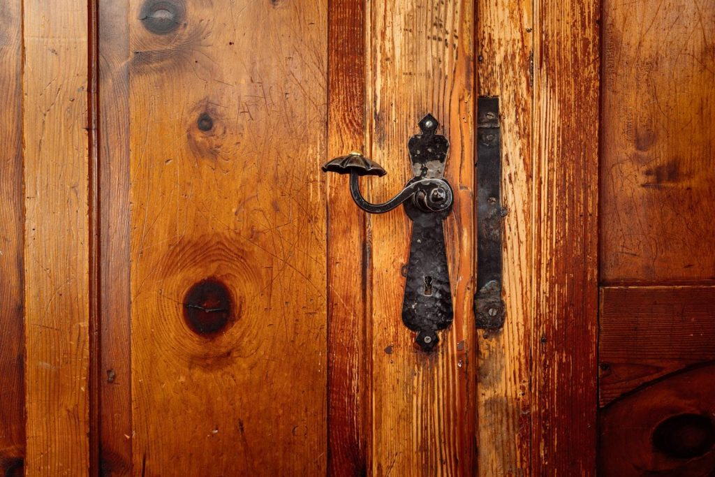 Door handle on an old wooden door